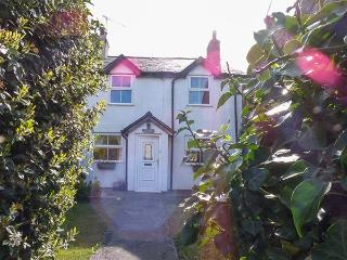 LLYS EIFION, semi-detached, three bedrooms, gardens, opposite owner's hotel, in
