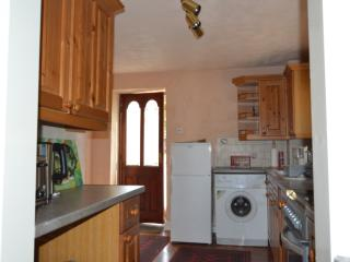 The kitchen is equipped with fridge/freezer, washing machine, electric oven, microwave