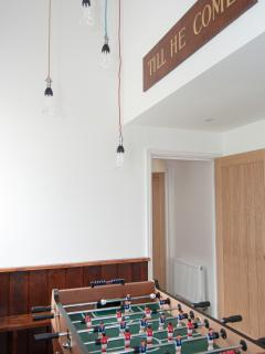 The original chapel sign and wood panelling in the table football area