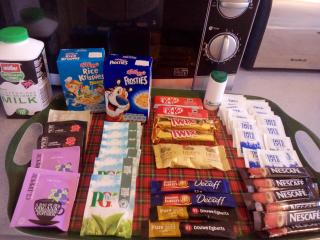 Free welcome pack with milk, tea, coffee, sugar, cereal and choc biscuits.