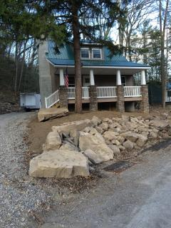 Landscaped with boulders from the property