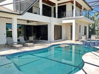 Modern waterfront house with rooftop observation deck, heated pool & hot tub