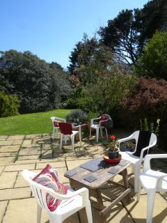 Main patio/al fresco dining area. South facing with second lawn ideal for younger children.