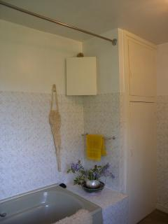 Bathroom 2 with Bath tub with show, toilet and wash hand basin. Also large airing cupboard.