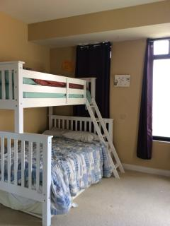 second bedroom with full size new bunk bed and pull out trundle to sleep 3 total