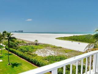 Front unit facing beach, w/ wraparound balcony for spellbinding views