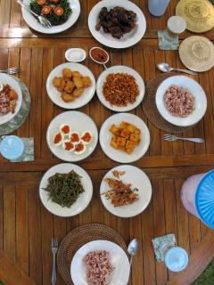 A typical Indonesian meal made by Mrs Made and served in the garden