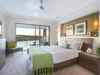 Master Bedroom with beautiful views over the lake to wake up to each morning.