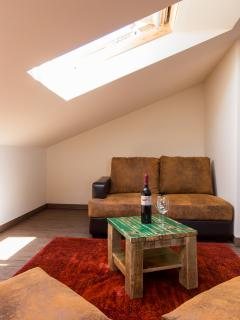 sunny attic room with sofa
