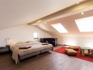 spacious attic, double bedroom with sofa, ocean view