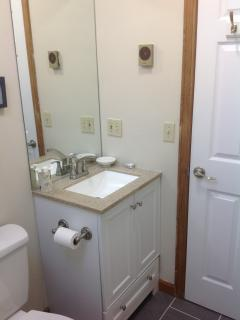 Upstairs bath has new vanity and granite top, fixtures.