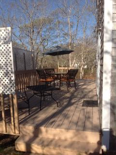 Deck spans entire depth of house.
