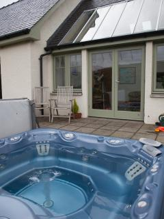 The giant hot-tub is perfect for relaxing after a busy day outdoors or to watch the stars at night