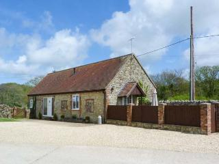 STABLE COTTAGE, ground floor, barn conversion with French doors from sitting roo