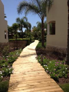The deck leading to the pool and gardens