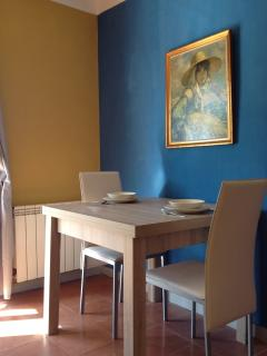 Extending dining table seats up to 6 but normally folded down for space saving