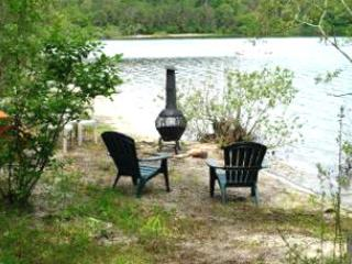 Private beach with chairs and outdoor fireplace. Outdoor grill unit also available.