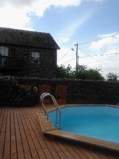New swimming pool surrounded on 3 sides by walls and one by fencing, lockable gates, safety lights
