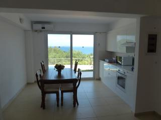 Dining area with patio doors onto terrace and wonderful views