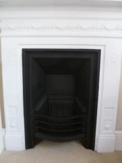 Period fireplace, twin room