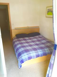 First Floor Bedroom with Double Bed and Balcony access