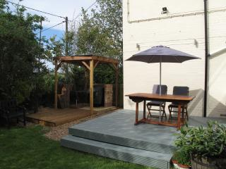 Raised deck area and covered barbeque