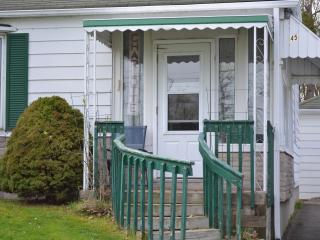 Front door leads into porch with a couch, then into the house