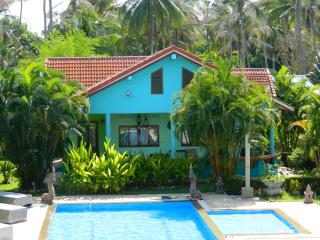 Lush 2 BRM bungalow with pool & tropical garden
