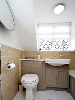 Family bathroom with bath and shower. Bath towels, hand towels and hand soap included.