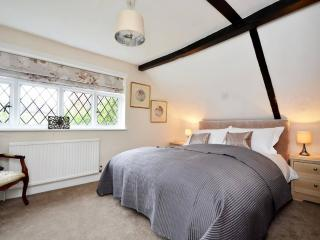 Pretty bedroom with Kingsize bed & original oak beams.