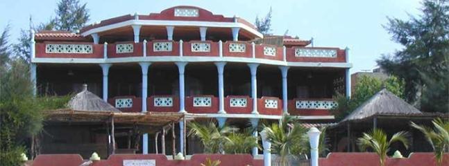 photo de la maison prise de la plage