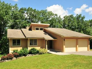 Spectacular 5 Bedroom home with hot tub located in prestigious community!