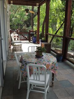 Take the long porch to the pool/spa deck, and relax in a porch swing, or dine on the table there