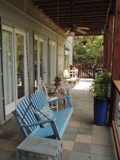 Two porch swings await you w/ the Main house porches, for relaxing /  enjoying nature all around.