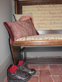 sit on the antique pew and take your walking boots off