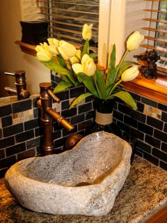 THE HOBBIT BATHROOM WITH A GRANITE BOULDER SINK