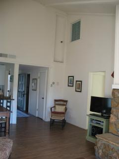 Soaring vaulted ceilings in living room