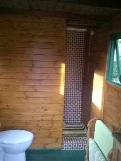 Shower room in the gypsy wagon also has a wash basin which is not shown here