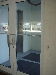 Glass Door and secure entrance to building and elevator.