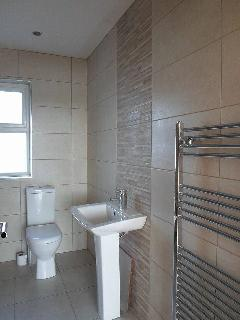 Family bathroom with P-shaped bath and electric shower