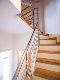 The stairs leading to the two bedrooms and main bathroom