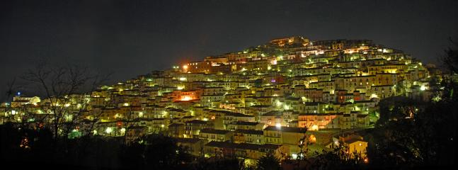 Our medieval hillside by night.  You will love the food, friendliness, and your stay here. Venire.