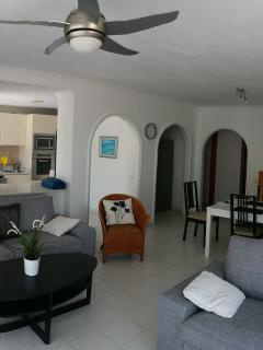A spacious open planned living area with HD television and wifi.