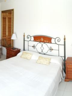 kingsize bed in large spacious beedroom, fitted double wardrobes views to mountains ad sea