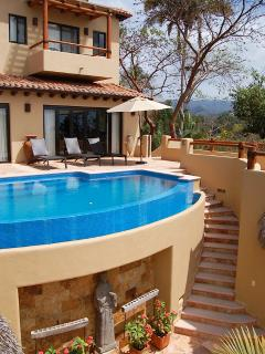 House view & pool terrace with stairs to lower bedrooms