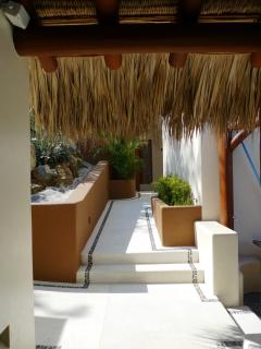 Solana pathways and garden areas provide a relaxed and private space