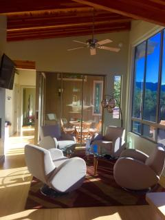 swivel chairs to enjoy the views, the TV or the fireplace
