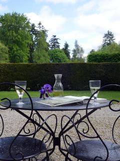 Table set for two in front 15th Century building housing gîtes.