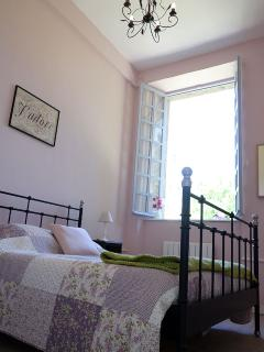 Furnished with a wrought iron style 5ft bed, bedside tables, chest of drawers, hanging space.