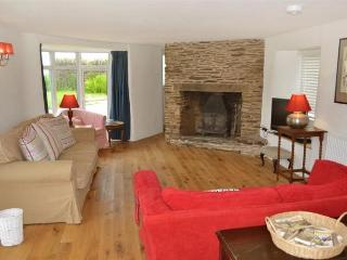 The spacious sitting room with inglenook fireplace.